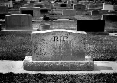 eerie: Gravestone in cemetery with words RIP rest in peace carved Stock Photo