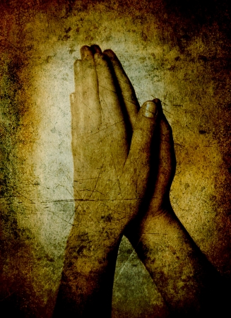 thankful: Hands of a person raised together in prayer sepia toned