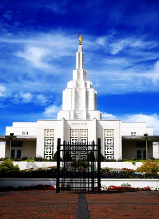 latter: Mormon Temple in Idaho Falls with blue sky and clouds in background