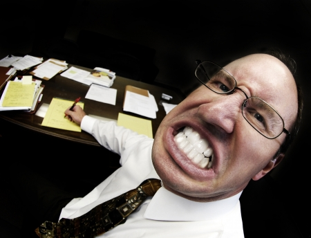 scowl: Mean looking man in business office gritting teeth Stock Photo