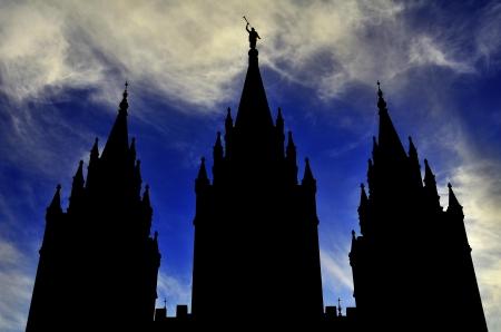 lds: Mormon LDS Salt Lake City Temple Silhouette against Blue Cloudy Sky