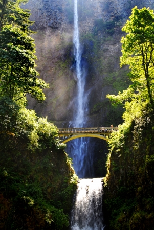 Multnomah waterfalls with bridge and water in background