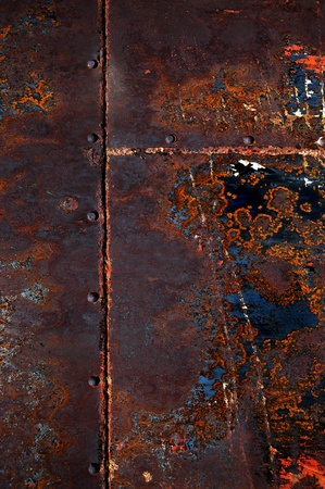 corrode: Detailed closeup of colorful rusty sheet of old steel Stock Photo