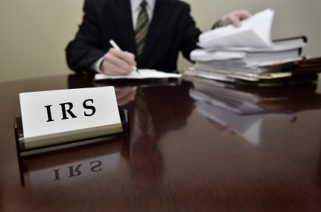 taxes: Auditor de impuestos del IRS hombre con una expresi?n severa o media Foto de archivo