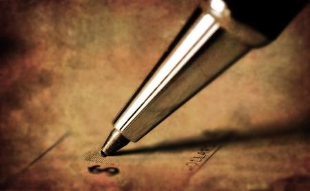 chequera: Pluma en la escritura antigua ver una cantidad de dinero