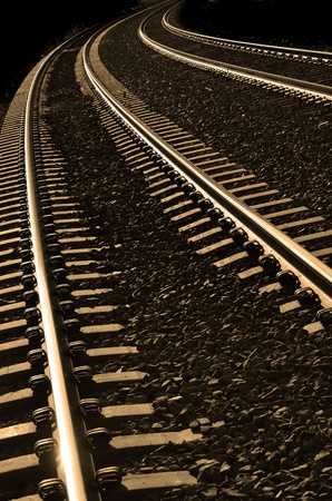 railway track: Long bright, railroad tracks curving around bend
