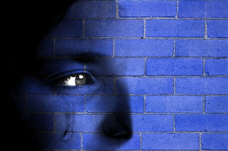 blending: Old blue brick wall with face blending in