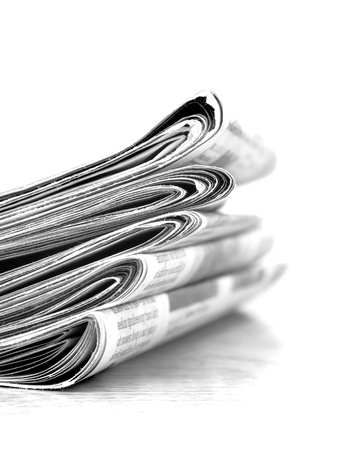 medium shot: Piled up newspaper isolated on white background Stock Photo