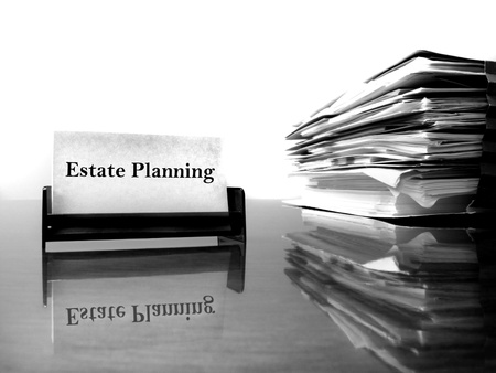 solicitor: Estate Planning business card on desk with files Stock Photo