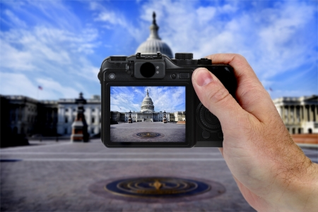 take a history: Hand holding camera taking photograph of US Capitol building by tourise Stock Photo