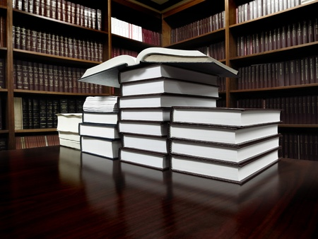 legal books: Stack of old books on a desk or table in a library Stock Photo