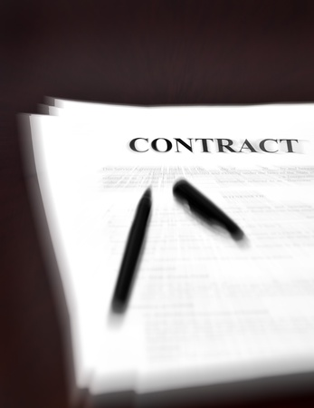 broken contract: Contract on desk with black pen waiting to be signed