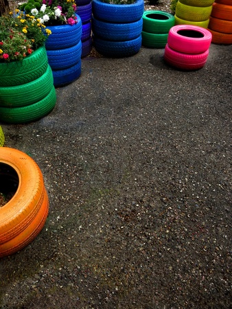 paintjob: Colorful tires piled up as planters for flowers