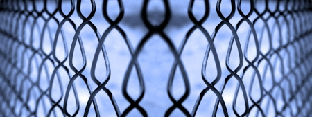 Chain Link Fence Keeping People in and Out Stock Photo - 22928126