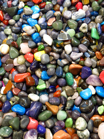 Pile of colorful smooth rocks as a background photo