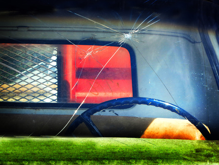 Detail Shot of a broken windshield on a Truck photo
