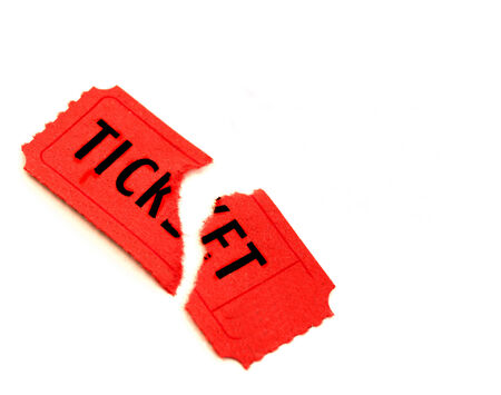 Single torn red ticket for admission to an event  Фото со стока