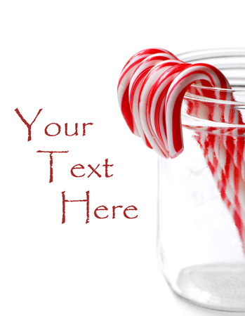 december 25th: Closeup of isolated candy canes in a jar Stock Photo