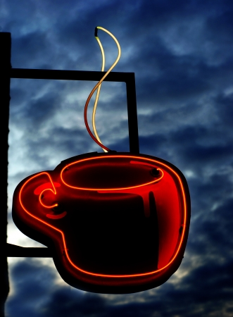 shop sign: Neon sign of steaming cup of hot coffee