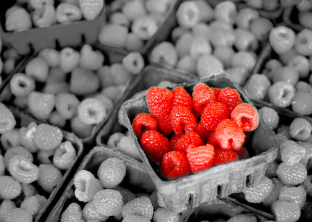 Fresh berries in bins on display for sale at the market