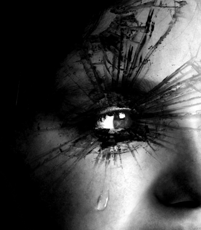Closeup of girl crying with tear rolling down her cheek with textured eyelashes