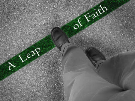 fresh start: Man walking across a green line with words a leap of faith Stock Photo