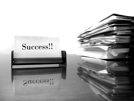 Business card on desk with files and word Success photo