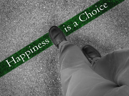 fresh start: Man walking across a green line with words happiness is a choice