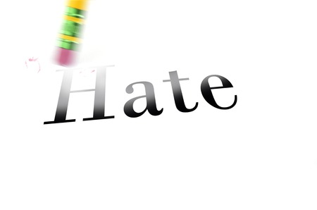 so: Person using a pencil eraser to erase Hate from their life so they can start new Stock Photo