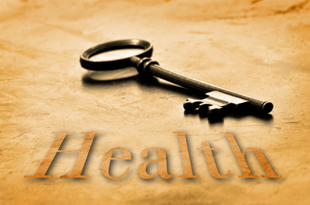 Key to Health on an old worn wooden desk top photo