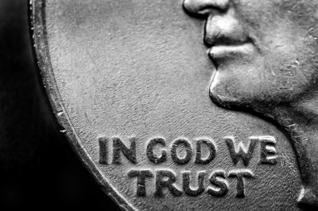 trust god: Coin of Silver American Money with words In God We Trust Stock Photo