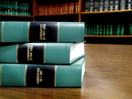 book shelf: Close up of several volumes of law books of codes and statutes on bankruptcy