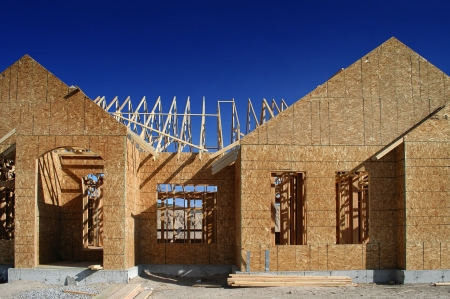 built: New home being built and detail of construction site Stock Photo