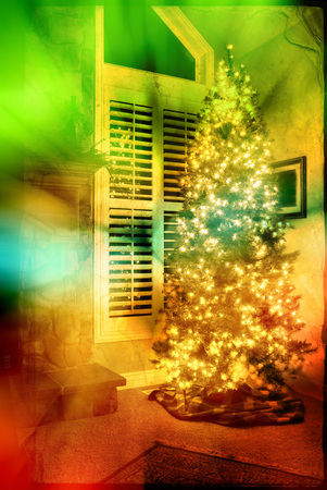 Front room of home next to window decorated for christmas with tree photo
