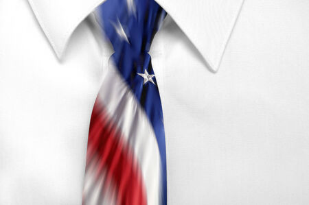 Closeup of white shirt and american flag tie photo