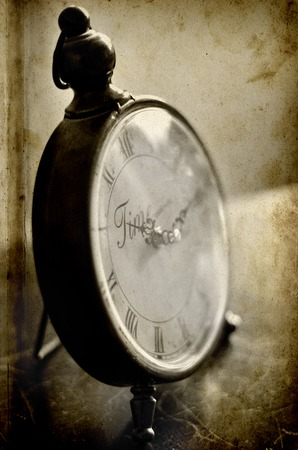 Detail of antique clock face with numbers and hands showing time Stock Photo