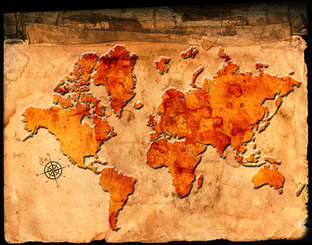Antique map of the world on parchment paper with relief or raised symbols photo