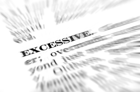 Closeup of definition of excessive from dictionary 版權商用圖片 - 26273362