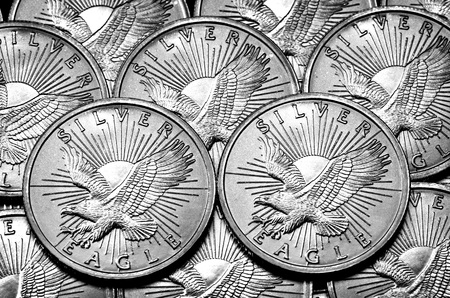 numismatics: Coins of Silver American Money with word Eagle Stock Photo