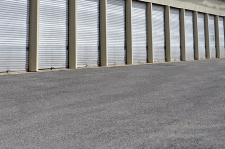 Detail of storage units building with sliding garage style doors Stock Photo