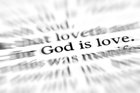 verse: Detail closeup zoom God is love scripture in bible verse Stock Photo