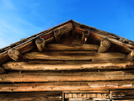 Old cabin roof logs blue sky symbolizing outdoors and recreation Stock fotó