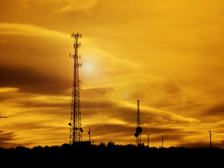 Silhouette of radio transmission tower for transmitting communication signals