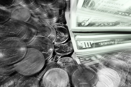 coin silver: Coins and dollar bills representing wealth and savings Stock Photo