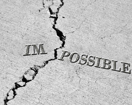 will power: Turning impossible into the possible cracked cement symbol