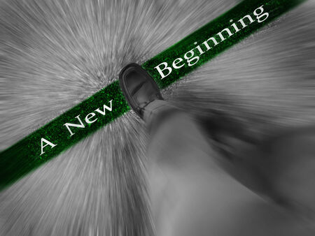 new beginning: Man walking across a green line with words A New Beginning Stock Photo