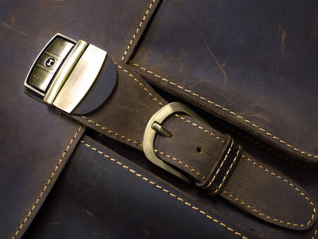clasp: Brass metal clasp on old leather case with hand stitching Stock Photo