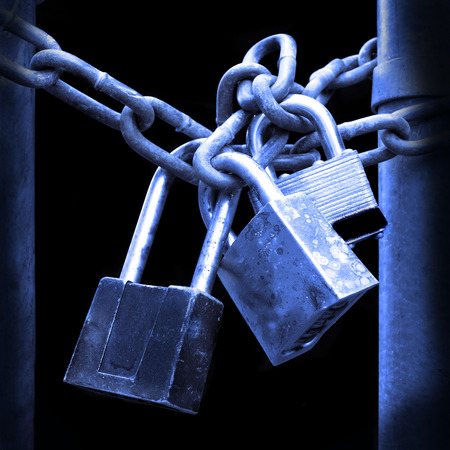 padlock: Several Locks and chain on fence gate for security