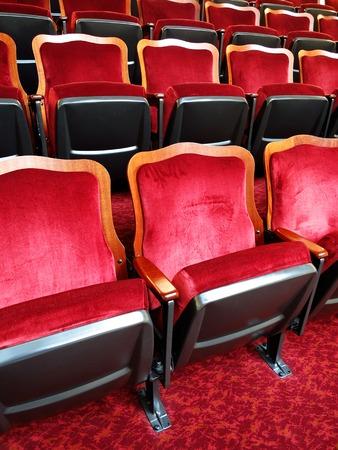 reserved seat: Row of elegant velvet theater seats Stock Photo