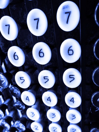 Detail of number keys on old adding machine photo